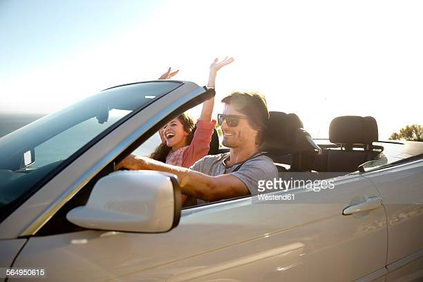 south africa, happy couple in convertible - convertible stock pictures, royalty-free photos & images