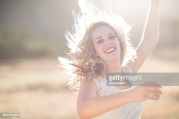 South Africa, Happy young woman dancing in field