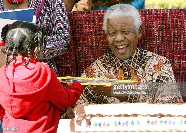 South Africa Johannesburg Former president of South Africa Nelson Mandela celebrating his 89th birthday with children from the Salvation Army