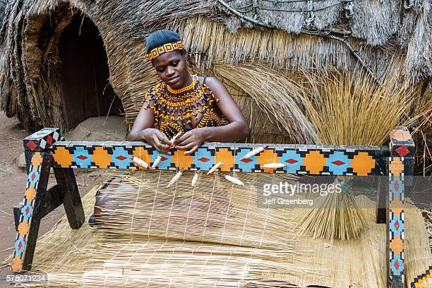 South Africa Johannesburg Lesedi Lodge Cultural Village Zulu tribe woman native regalia traditional dress clothing tribal village making grass...