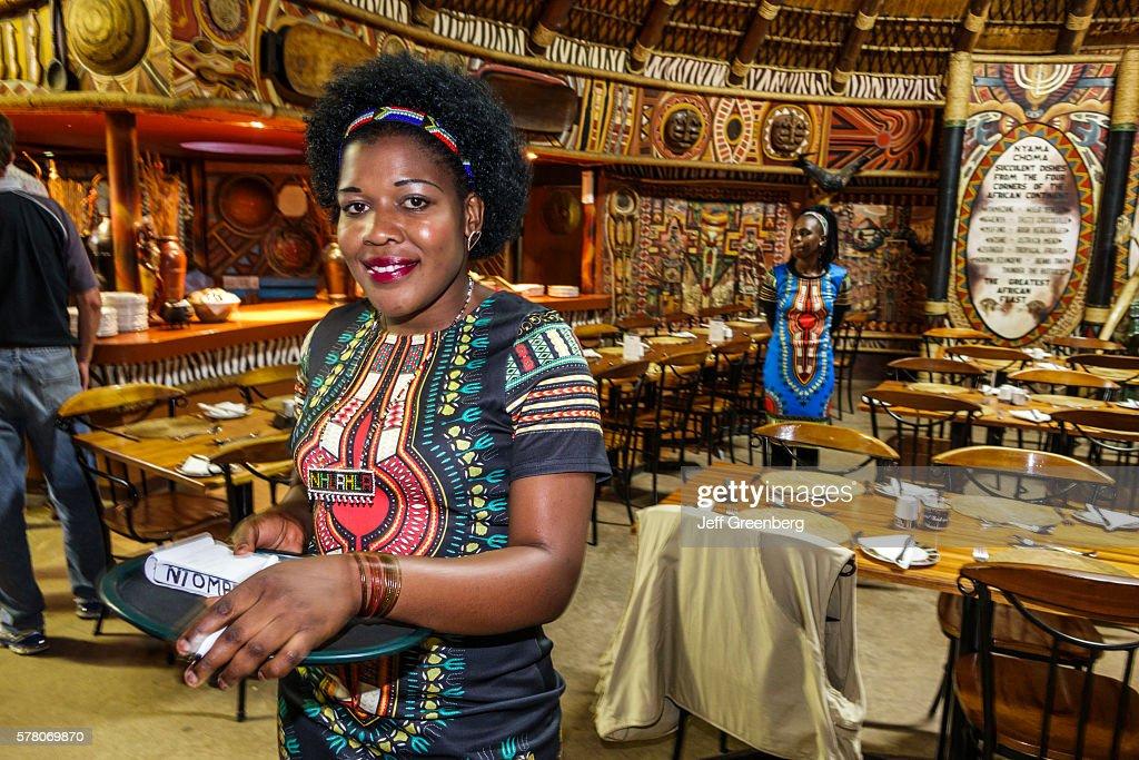Lesedi Lodge & Cultural Village Nyama Choma restaurant inside waitress wearing dashiki : News Photo