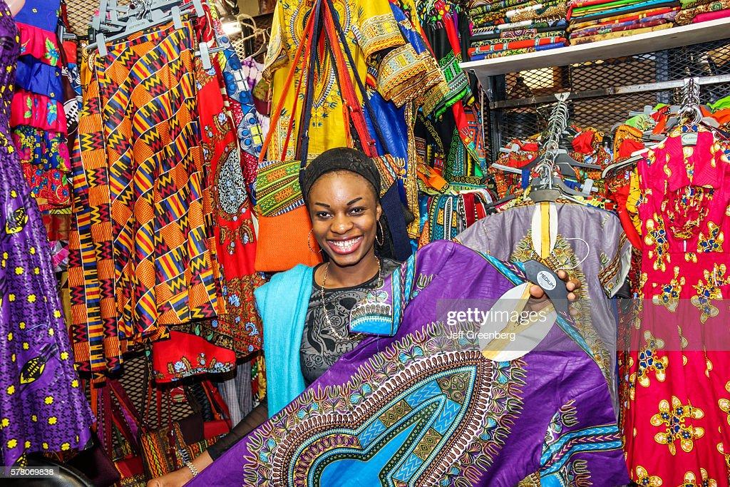 Rosebank Mall Flea Market, vendor stall couple looking at dashiki gown : News Photo