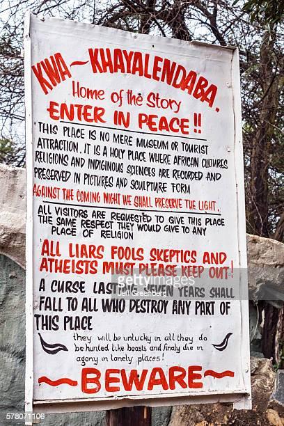 South Africa Johannesburg Soweto KwaKhaya Lendaba Credo Mutwa Cultural Village sign entrance warning curse