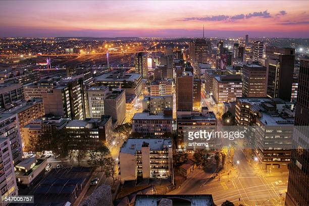 South Africa, Johannesburg, Sunset view of skyline and Nelson Mandela Bridge