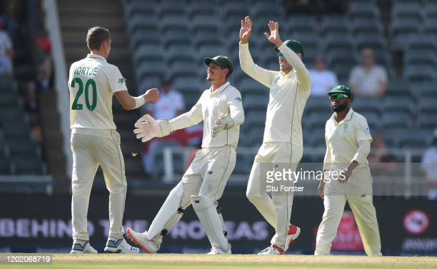 South Africa keeper Quinton de Kock celebrates with Anrich Nortje after the pair combined to dismiss Ollie Pope and bring up de Kock's 200th Test...