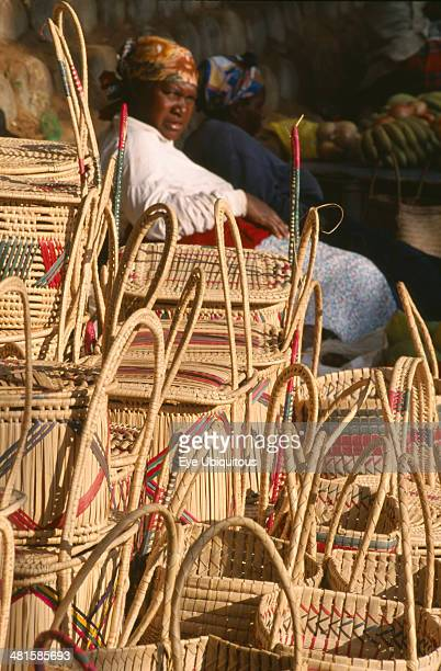 South Africa KwaZuluNatal St Lucia Village Zulu woman selling hand woven baskets made from Lala Palm Hyphaene Coriacea