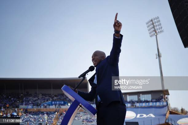South Africa main opposition Party Democratic Alliance leader Mmusi Maimane gestures as he delivers a speech on stage to supporters at the...