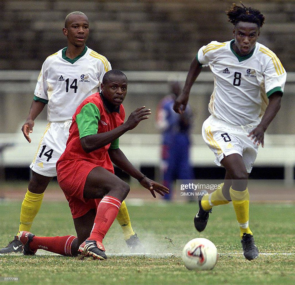 South africa manpoba ngwenya r takes t pictures getty images south africa manpoba ngwenya r takes the ball past kenyan andrew oyombe as gift negle Choice Image
