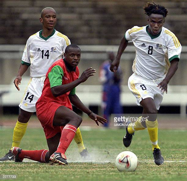 Gift leremi pictures and photos getty images south africa manpoba ngwenya takes the ball past kenyan andrew oyombe as gift leremi watches 28 negle Images