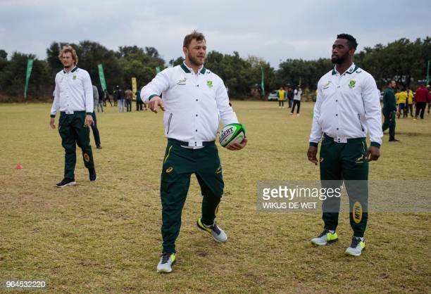 South Africa national Springbok captain Siya Kolisi and Duane Vermeulen attend a rugby clinic coaching session with aspiring rugby players from...