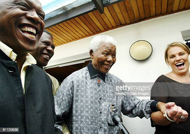 South Africa Nelson Mandela leaves the Houghton Golf Club after voting With him are Zelda le Grange and Tokyo Sexwale