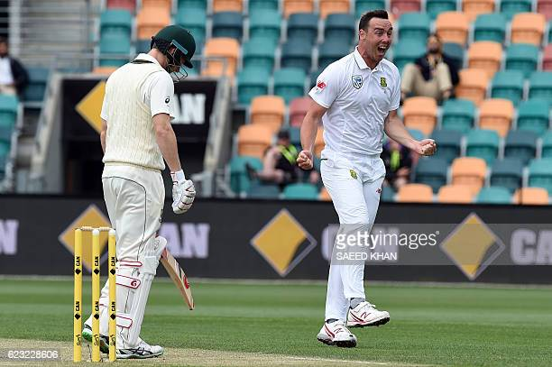 South Africa paceman Kyle Abbott celebrates his wicket of Australia's batsman Adam Voges on the fourth day's play of the second Test cricket match...