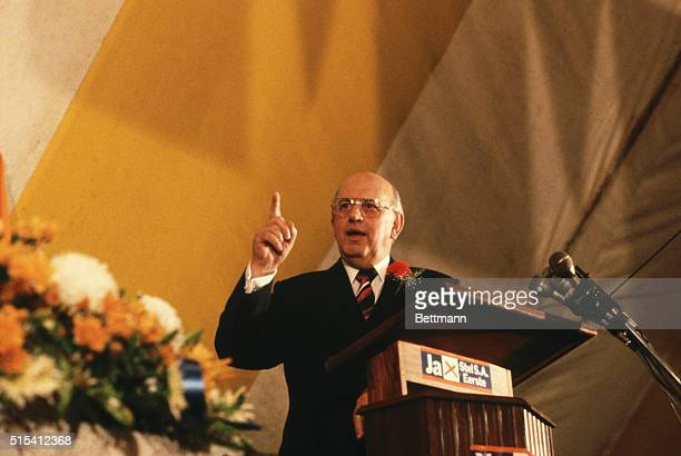 Pieter Willem Botha Prime Minister of South Africa standing at a podium during a press conference He is pointing with his index finger