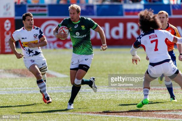 South Africa player sprints between Madison Hughes of USA and Folau Niua during the Cup Semi Final match between South Africa and the United States...