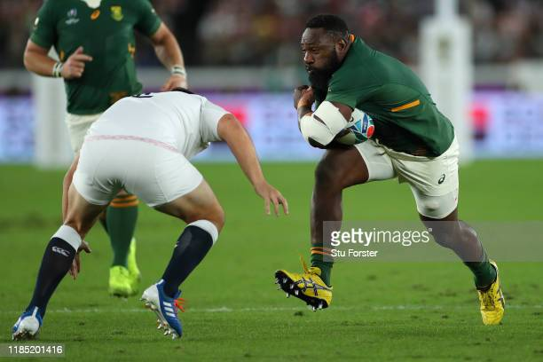 South Africa player Tendai Mtawarira runs at the England defence during the Rugby World Cup 2019 Final between England and South Africa at...