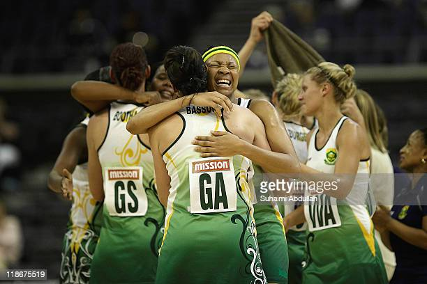 South Africa players celebrate after winning their match against Malawi on day eight of the 2011 World Netball Championships at Singapore Indoor...