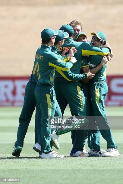 South Africa players celebrate the dismissal Mohammed Tawhid Hridoy of Bangladesh during the ICC U19 Cricket World Cup 5th Playoff match between...