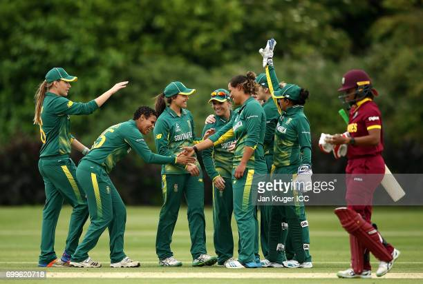 South Africa players celebrate the wicket of Chedean Nation of West Indies during the ICC Women's World Cup warm up match between West Indies and...