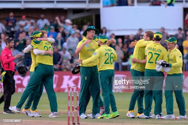 South Africa players celebrate their win in the second T20 international cricket match against Australia at the St George's Park Cricket Ground in...