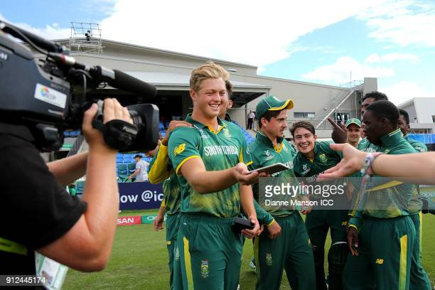 South Africa players pose for a team selfie after the ICC U19 Cricket World Cup 5th Playoff match between South Africa and Bangladesh at John Davies...