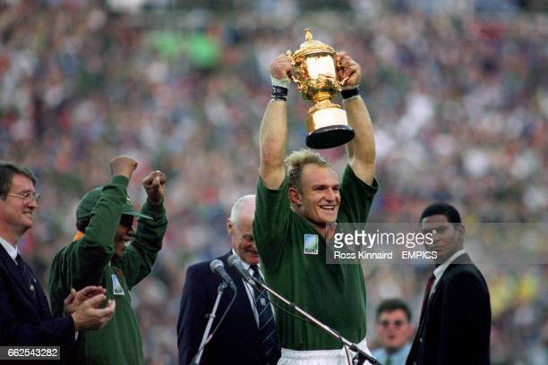 South Africa President Nelson Mandela cheers as Francois Pinaar lifts the trophy