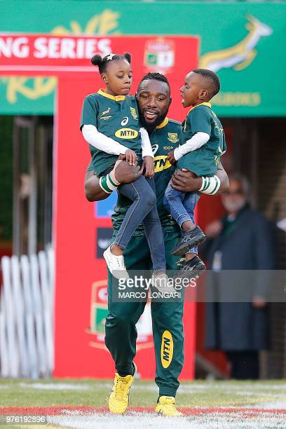 South Africa prop Tendai Mtawarira carries his children Tawumba and Wangu during the opening of the second test match between South Africa and...