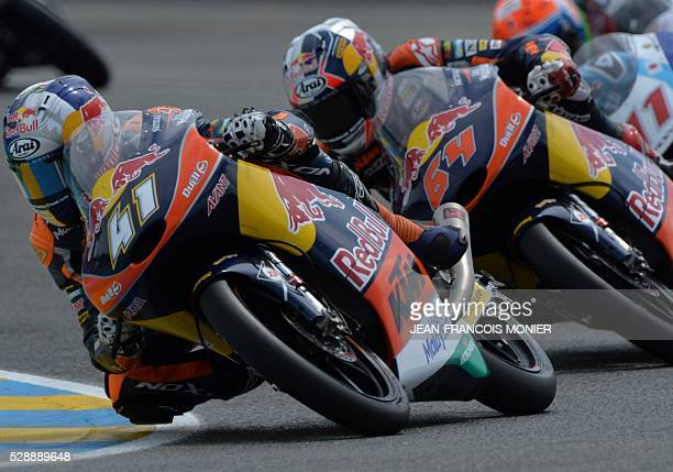 South Africa rider Brad Binder competes on his Red Bull KTM Ajo N��41 ahead Netherlands rider Bo Bendsneyder on his Red Bull KTM Ajo N��64 and...