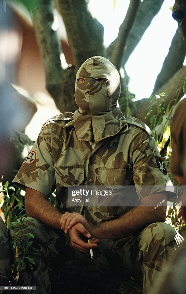 South Africa, Rustenburg, masked man from Afrikaner Resistance Movement smoking : News Photo