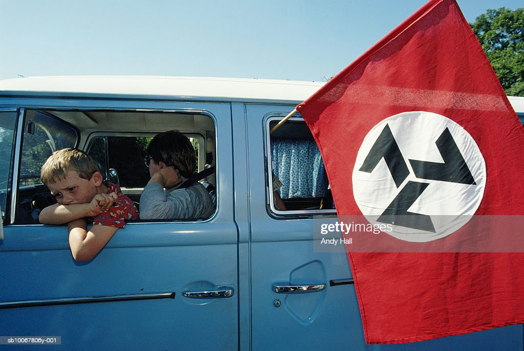 South Africa, Rustenburg, mother and son 910-11) in van with AWB flag