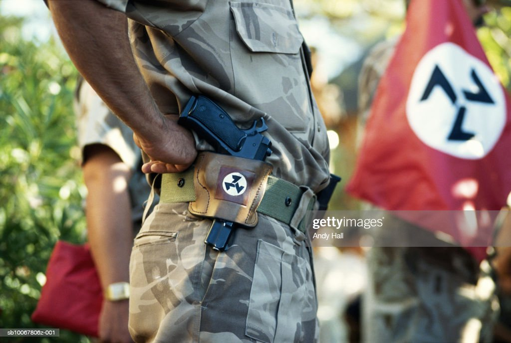 South Africa, Rustenburg, mid section of Afrikaner with gun : News Photo