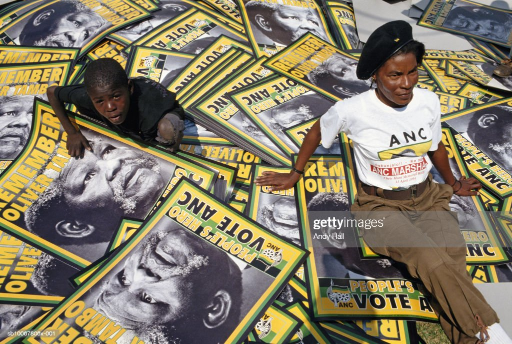 South Africa, Soweto,  African National Congress Rally, woman and boy (10-11) sitting on placards : News Photo
