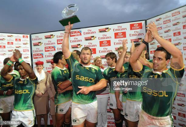 South Africa Springboks players celebrate with the trophy after winning the Plante final against Argentina on day 2 of the HSBC Sevens World Series...