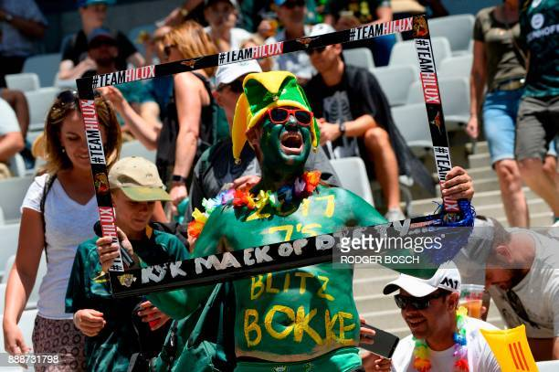 South Africa supporter reacts during the World Rugby Sevens Series on December 9, 2017 at the Cape Town Stadium in Cape Town. / AFP PHOTO / RODGER...