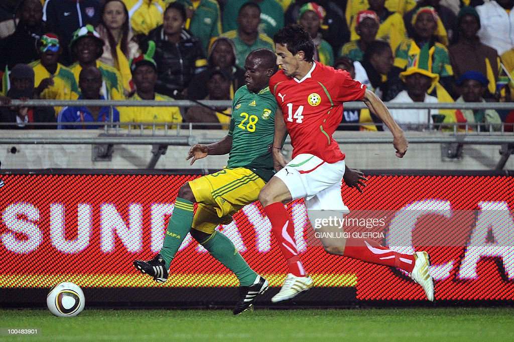 South Africa Thwala Lucas(L) and Bulgaria Stanislav Manolev(R) fight for the ball during their international friendly football match at the Orlando stadium in Soweto, Johannesburg. on May 24, 2010. The 2010 FIFA World Cup football championship is due to take place in South Africa from June 11 to July 11 of 2010.