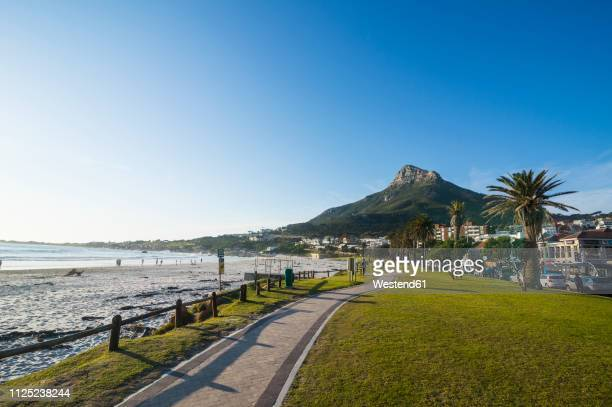 south africa, waterfront of camps bay with the lions head in the background, suburb of cape town - cape town stock pictures, royalty-free photos & images