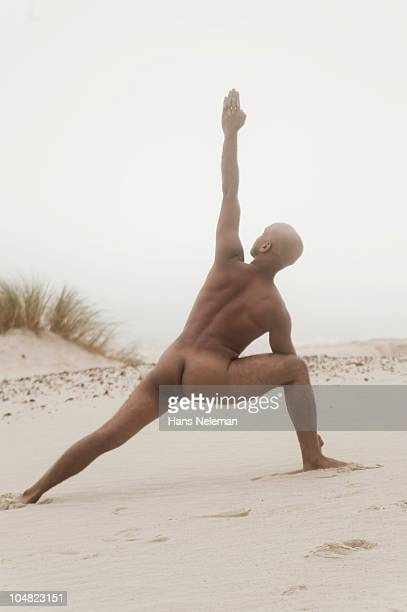 South Africa, Western Cape Province, Cape Town, Naked man doing yoga in landscape