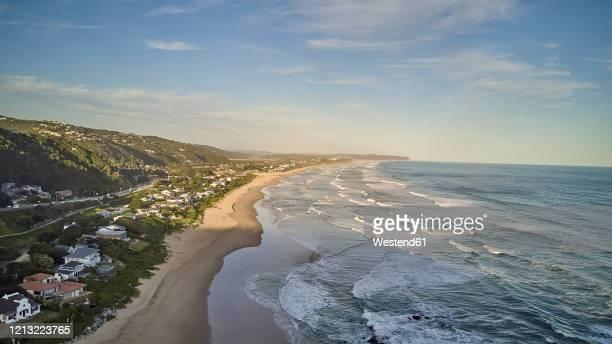 south africa, western cape, wilderness, aerial view of town along coast ofindian ocean at dusk - westliche kapprovinz stock-fotos und bilder