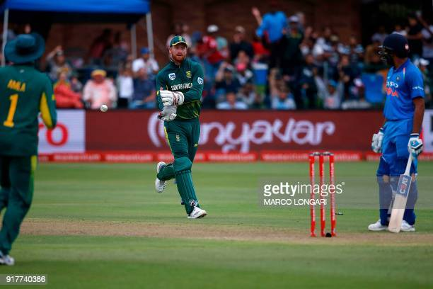 South Africa wicket keeper Heinrich Klaasen runs to celebrate after having caught out India batsman Ajinkya Rahane during the fifth One Day...