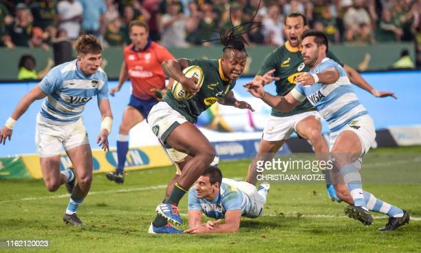 South Africa wing Sbu Nkosi prepares to score a try during the 2019 Rugby Union World Cup warmup test match between South Africa against Argentina at...