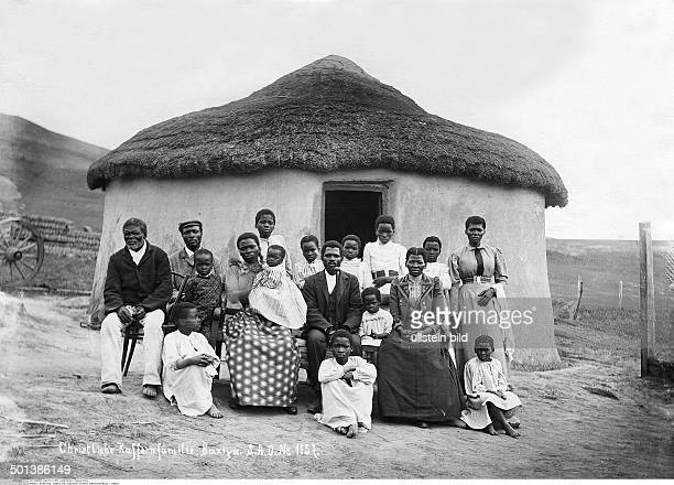 South Africa Xhosa family in European dress in front of their house probably in the 1910s