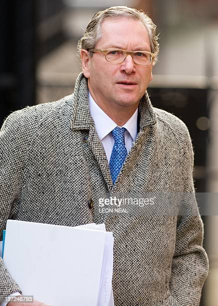 South Africaborn journalist John Witherow the editor of the Sunday Times newspaper arrives at the High Court in central London on January 17 to give...