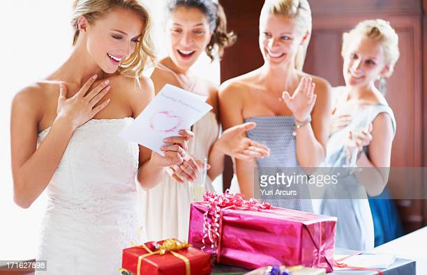 south africa,cape town, bride and bridesmaids unpacking gifts - bridesmaid stock pictures, royalty-free photos & images