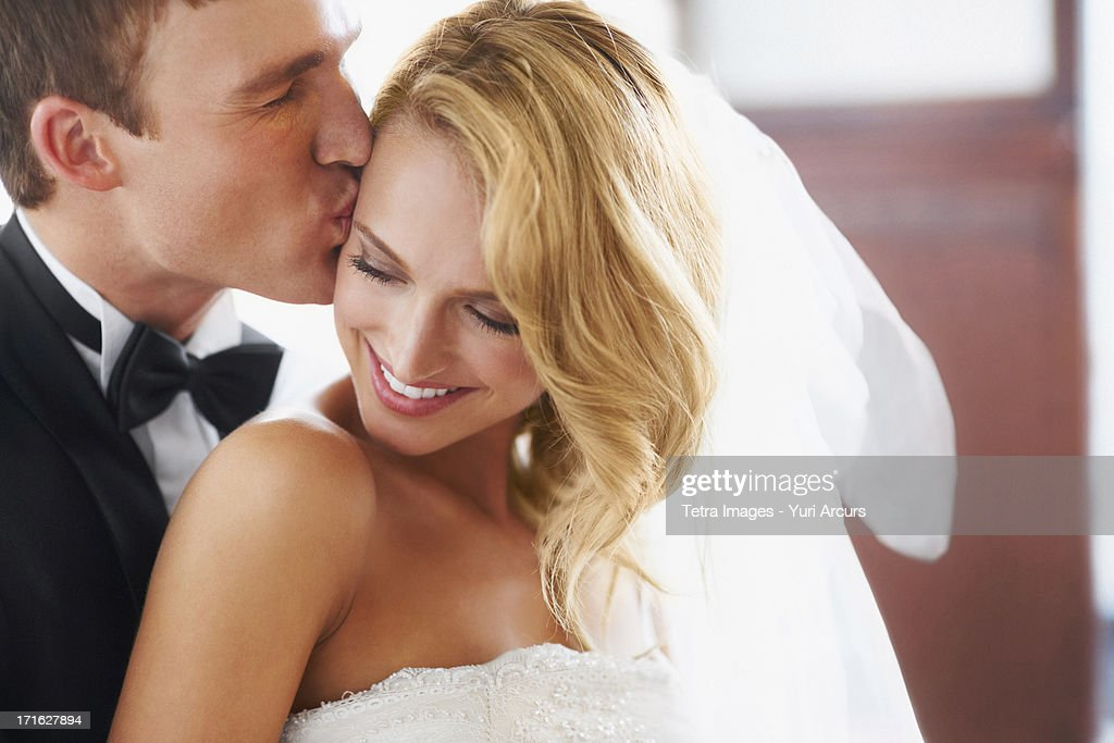 South Africa,Cape Town, Groom kissing bridge : Stock Photo