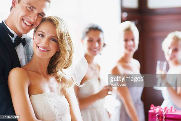 South Africa,Cape Town, Portrait of newly wed couple, bridesmaids in background