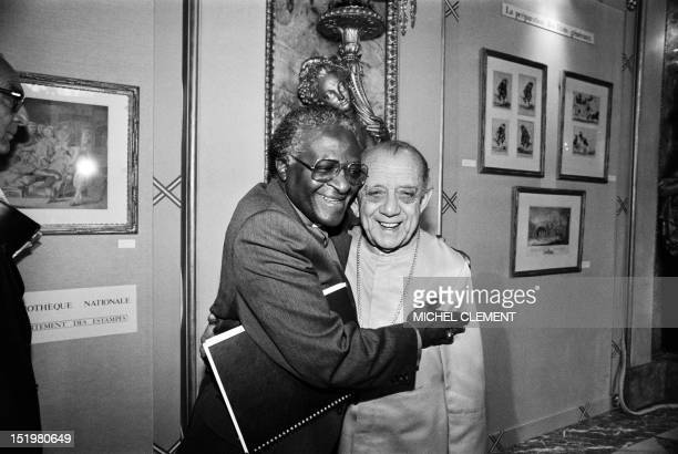 South African activist and Nobel Peace Prize and Anglican Archbishop Desmond Tutu hugs Archbishop Dom Helder Camara of Brazil at the hotel de Lassay...