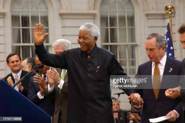 South African activist and politician Nelson Mandela and New York City Mayor Michael Bloomberg attend the 2002 Tribeca Film Festival's Opening Night...