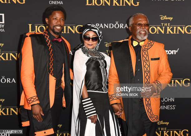 "South African actor Atandwa Kani and his parents Mandi Kani and John Kani arrive for the world premiere of Disney's ""The Lion King"" at the Dolby..."
