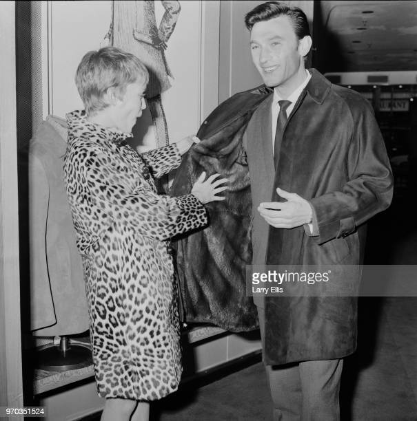South African actor Laurence Harvey shopping with American actress Mia Farrow in Regent Street London UK 16th February 1967