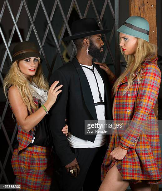 South African actress Angelique Gerber and Icelandic Olympic swimmer Ragga Ragnarsdottir pose with Karim Odoms during photoshoot at Arts District...