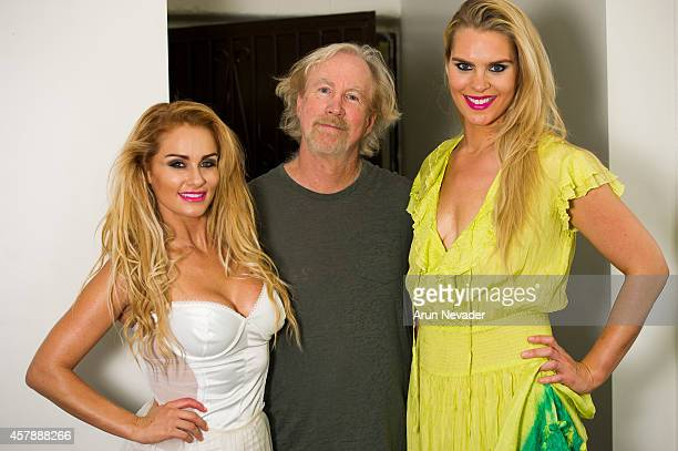 South African actress Angelique Gerber and Icelandic Olympic swimmer Ragga Ragnarsdottir backstage with Ron Garrett CEO of eSoundlink Inc during...